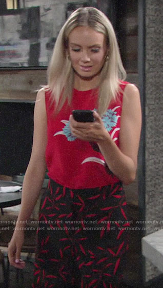 Abby's red floral top and leaf print pants on The Young and the Restless