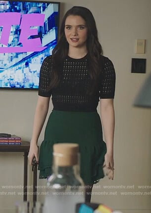 Jane's black short sleeve sweater and green eyelet skirt on The Bold Type