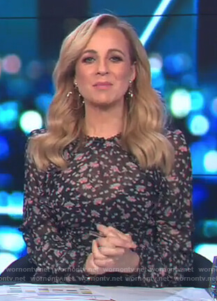 Carrie's black floral print dress on The Project