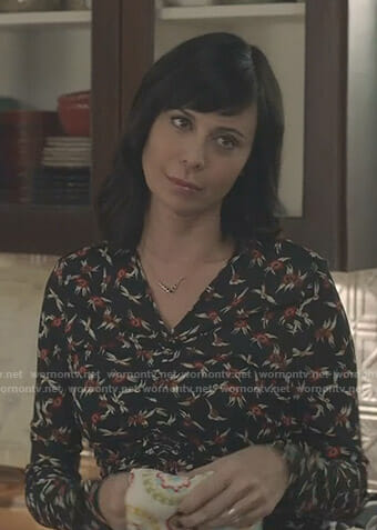 Cassie's black floral ruched front top on Good Witch