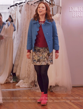 Kimmy's blue scalloped jacket and cat print skirt on Unbreakable Kimmy Schmidt