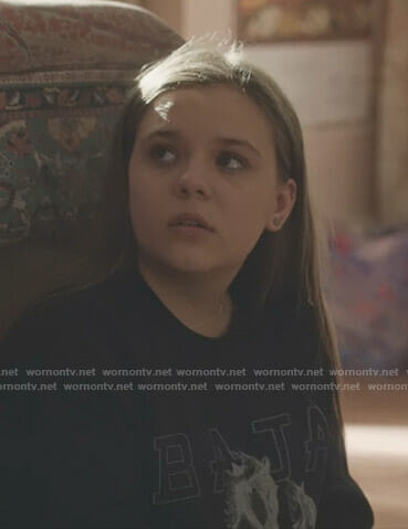 Daphne's black Baja East horse print sweatshirt on Nashville