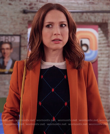 Kimmy's navy diamond sweater on Unbreakable Kimmy Schmidt