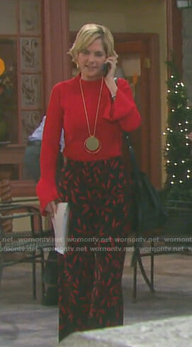 Eve's red bell sleeve top and printed wide-leg pants on Days of our Lives