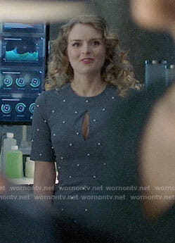 Eve's blue ruffled neck top on Supergirl