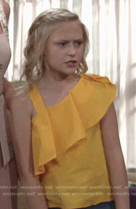 Faith's yellow ruffled top on The Young and the Restless