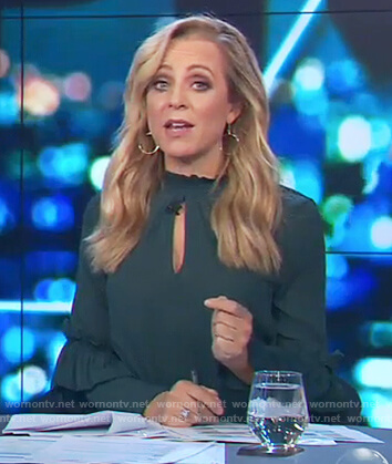 Carrie's green keyhole ruffle top on The Project