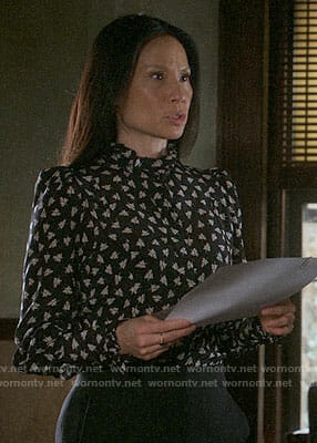 Joan's black leaf print blouse on Elementary
