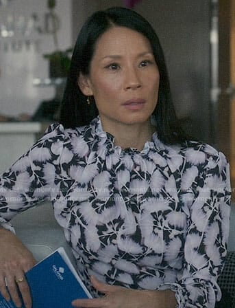 Joan's floral smocked neck blouse on Elementary