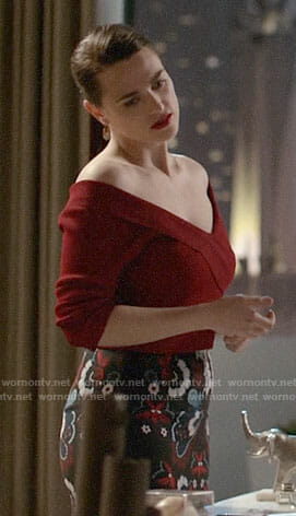 Lena's red off-shoulder top and printed pencil skirt on Supergirl