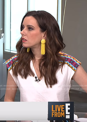 Melanie's white v-neck top with embroidery on Live from E!