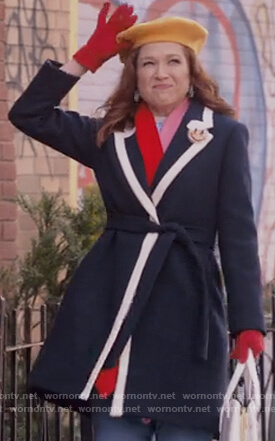 Kimmy's navy tipped coat on Unbreakable Kimmy Schmidt