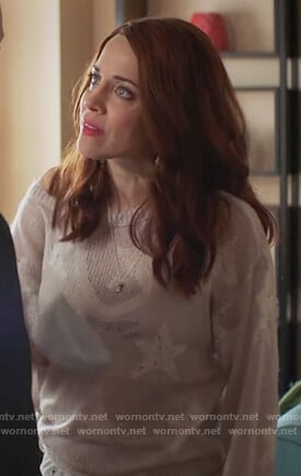Jo's pink distressed star sweater on Girlfriends Guide to Divorce