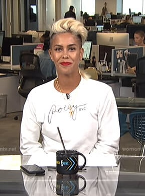 Sibley's white Poesy NYC sweatshirt on Live from E!