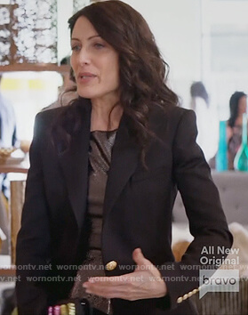 Abby's black single button blazer and clutch bag on Girlfriends Guide to Divorce