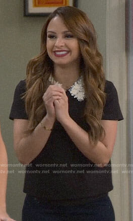 Sofia's black top with floral collar on Young and Hungry