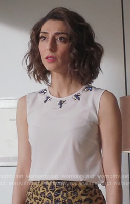 Delia's white dragon fly embellished neckline top on Girlfriends Guide to Divorce