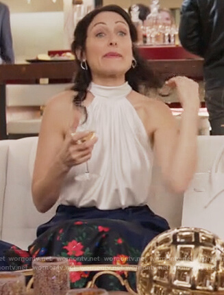 Abby's white satin halter neck top on Girlfriends Guide to Divorce
