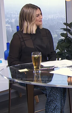 Carissa's black sheer blouse and printed pants on E! News Daily Pop