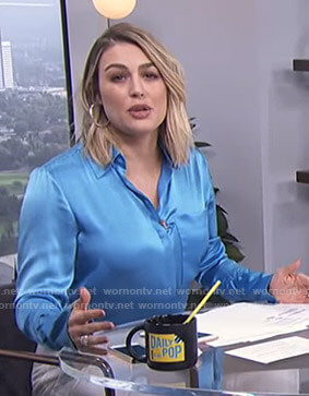 Carissa's blue shirt with lace up cuffs on E! News Daily Pop