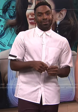Justin's white short sleeve shirt on E! News