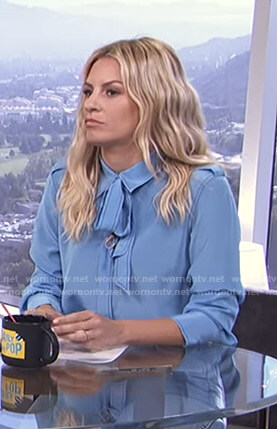 Morgan's blue tie neck blouse on E! News Daily Pop