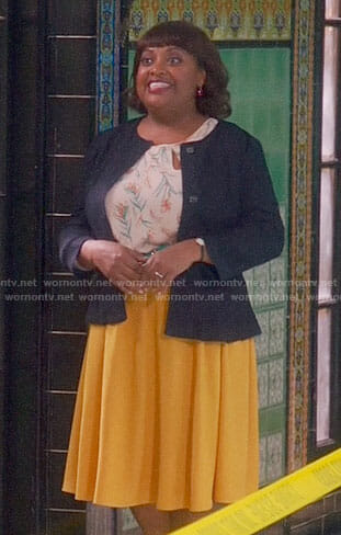 Anne's floral keyhole top and yellow skirt on Trial and Error