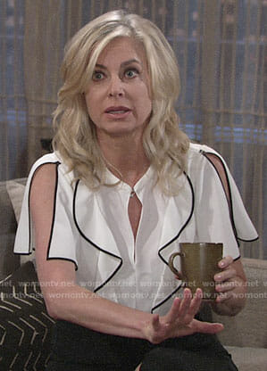 Ashley's white ruffled blouse with black trim on The Young and the Restless