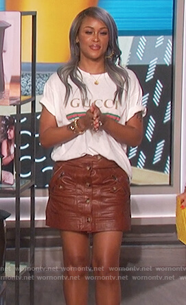 Eve's white Gucci tee and brown leather skirt on The Talk