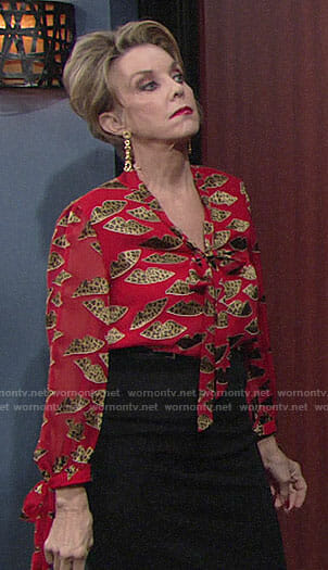 Gloria's red blouse with leopard print lips on The Young and the Restless