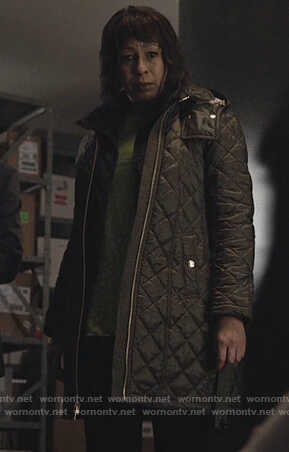 Julia's green quilted jacket on Dietland