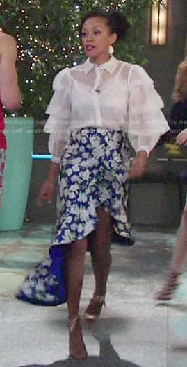 Hilary's blue floral high-low skirt and white ruffled shirt on The Young and the Restless