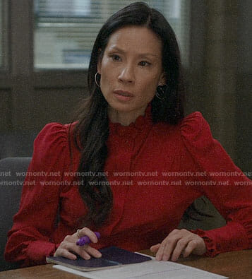 Joan's red puff-shoulder top on Elementary