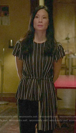 Joan's striped asymmetric top on Elementary