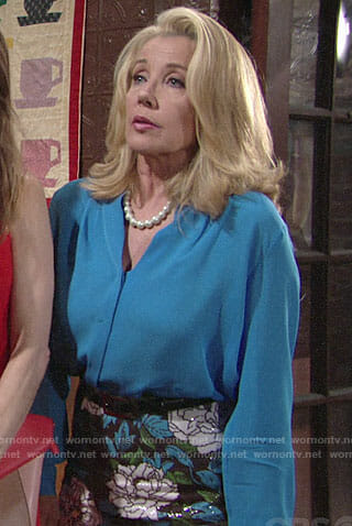 Nikki's blue blouse and floral sequin skirt on The Young and the Restless