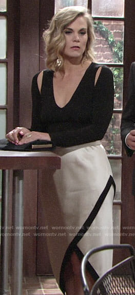 Phyllis's black top with cutouts and white skirt on The Young and the Restless