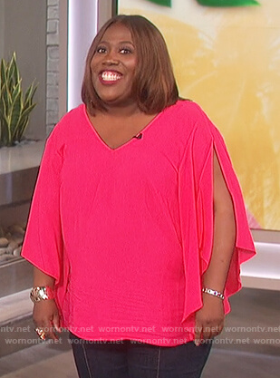Sheryl's pink split sleeve top on The Talk