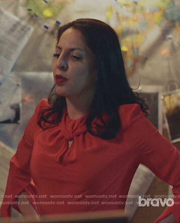 Camila's red twisted blouse and print pencil skirt on Queen of the South