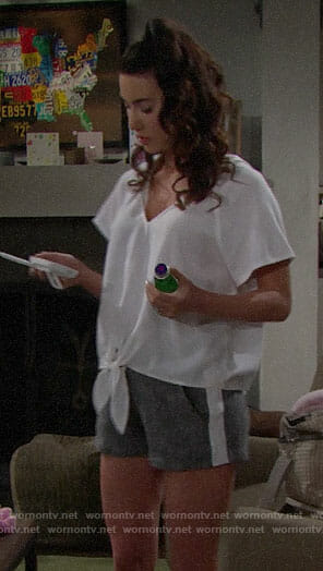 Steffy's white tie-front hoodie and side-stripe shorts on The Bold and the Beautiful