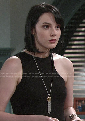 Tessa's black asymmetric top and fringed pendant necklace on The Young and the Restless