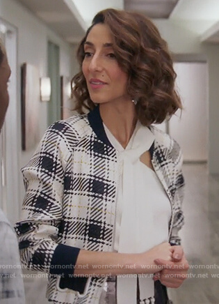 Delia's white checked bomber jacket and tassel tie neck top on Girlfriends Guide to Divorce
