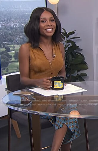 Zuri's orange ribbed top and printed trousers on E! News Daily Pop