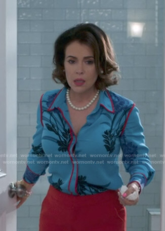 Coralee's blue floral shirt on Insatiable