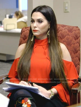D'Andra's red cold-shoulder top and floral boots on The Real Housewives of Dallas