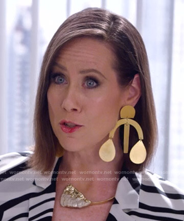 Diana's gold statement earrings on Younger
