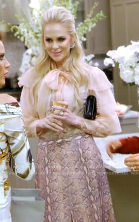 Kameron's pink ruffled blouse and snake print skirt on The Real Housewives of Dallas