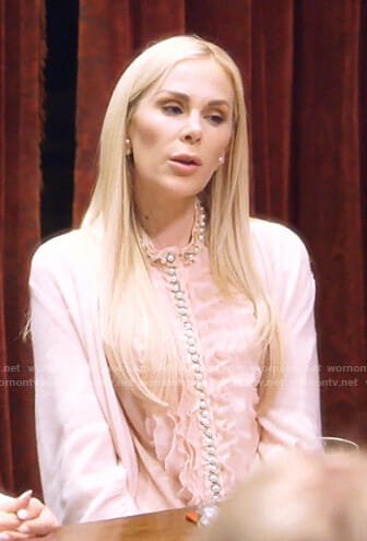 Kameron's pink ruffled blouse with pearl buttons on The Real Housewives of Dallas