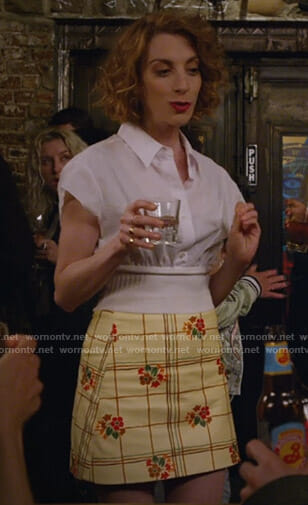 Lauren's white waistband shirt and floral mini skirt on Younger