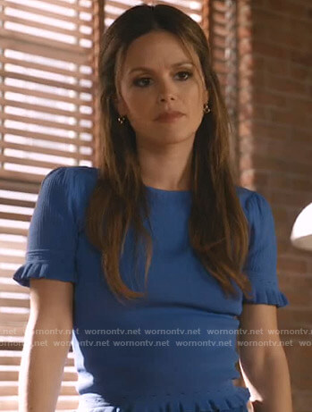 Sam's blue ruffled short sleeve top on Take Two