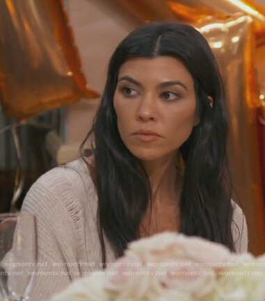 Kourtney's beige distressed sweater on Keeping Up with the Kardashians